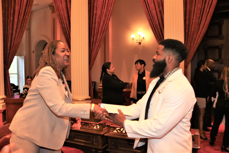 State Senator Holly Mitchell welcomes, CDU Med Student Rasheed Ivey