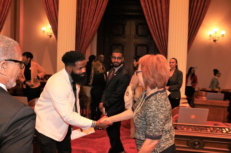 Soon to be MD, Rasheed Ivey greets CA State Senator Maria Elena Durazo.