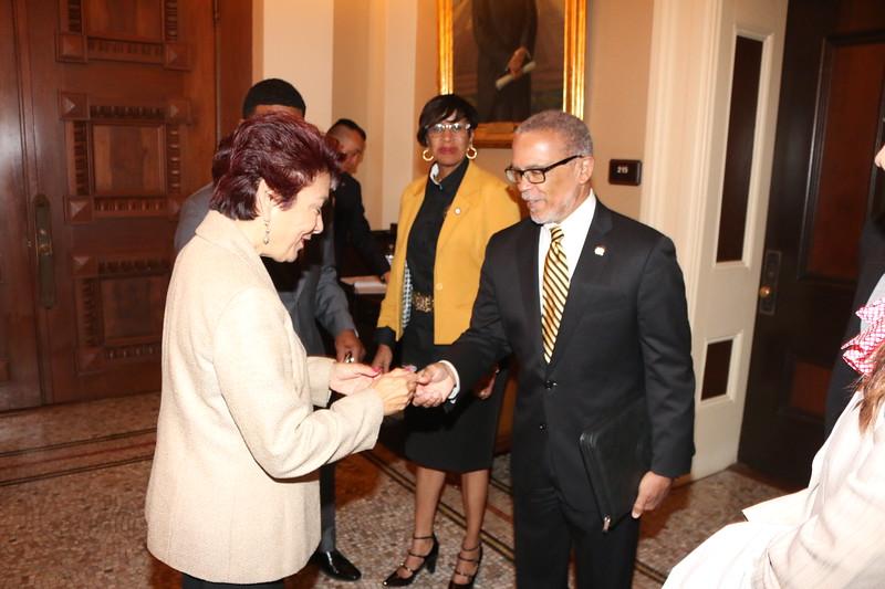 CDU President David M. Carlisle presents CA State Senator Anna M. Caballero with a CDU lapel pin.