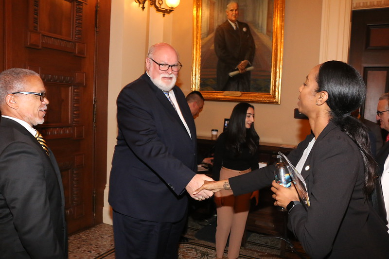 CA State Senator Jim Beall greets CDU student Maria Kemp, from the Mervyn M. Dymally School of Medicine.