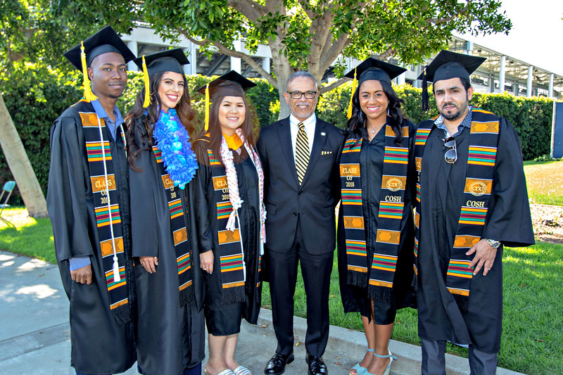 President David Carlisle flanked by soon to be graduates of the College of Science and Health.