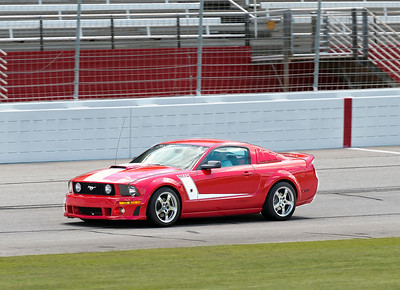 The owner of this Roush Edition Ford Mustang was enjoying being able to open it up and run around the track. The photo doesn't really give a sense of his speed except that the radio antenna is bending back nicely.