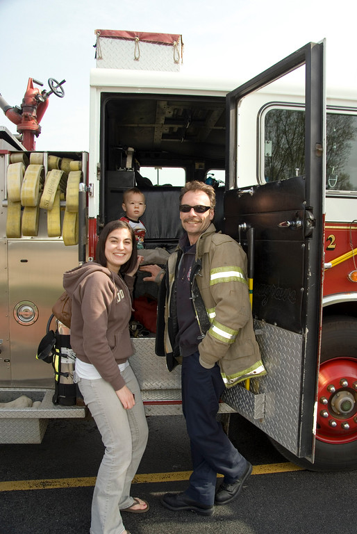 Elgin Firefighter Pierre Soulier giving 2 year old J.J. Gonnam and his mother Jennifer the grand tour of Fire Engine #2 before they went in to get their .31 cent scoop of ice cream at Baskin Robbins on Rt. 31 and Tollgate Rd.