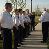 """Elgin Fire Chief John Henrici gives his commencement talk before raising the flag and putting the station """"In Service""""."""