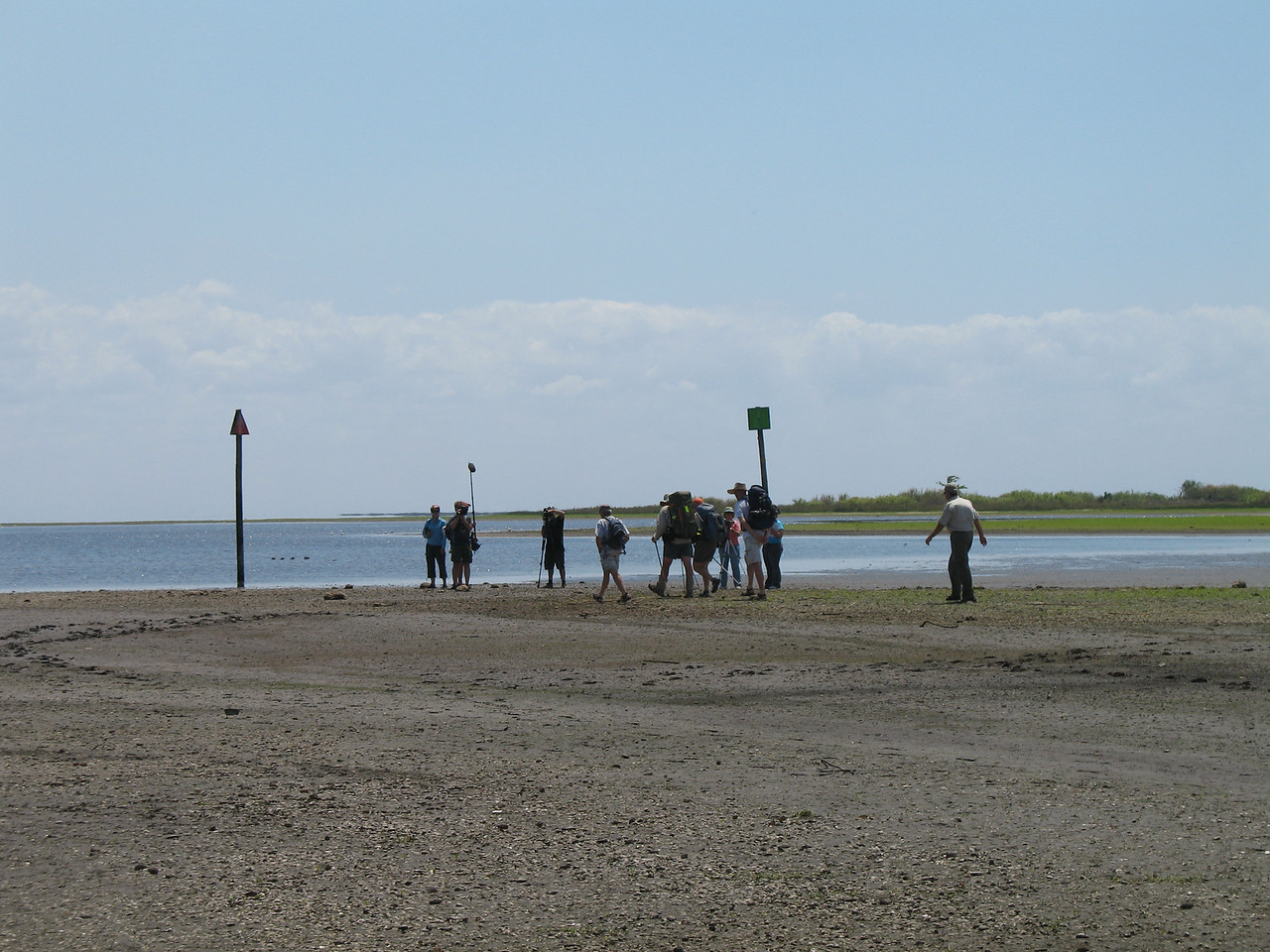 The hikers and camera crew head for the shore