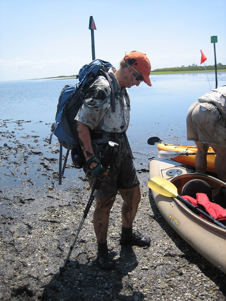 Beth emerges from the muck to help with the Pungo<br /> Photo credit: FTA / Rob Smith, Jr.