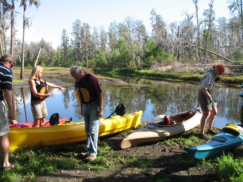 Harris Rosen and Jena Brooks of OGT prep their canoe as Beth finishes packing