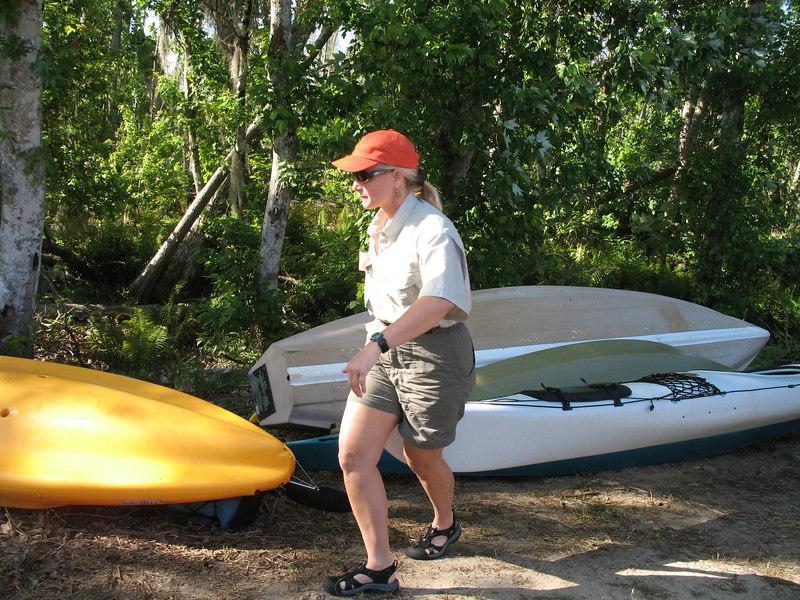 Beth lugs her canoe to Shingle Creek