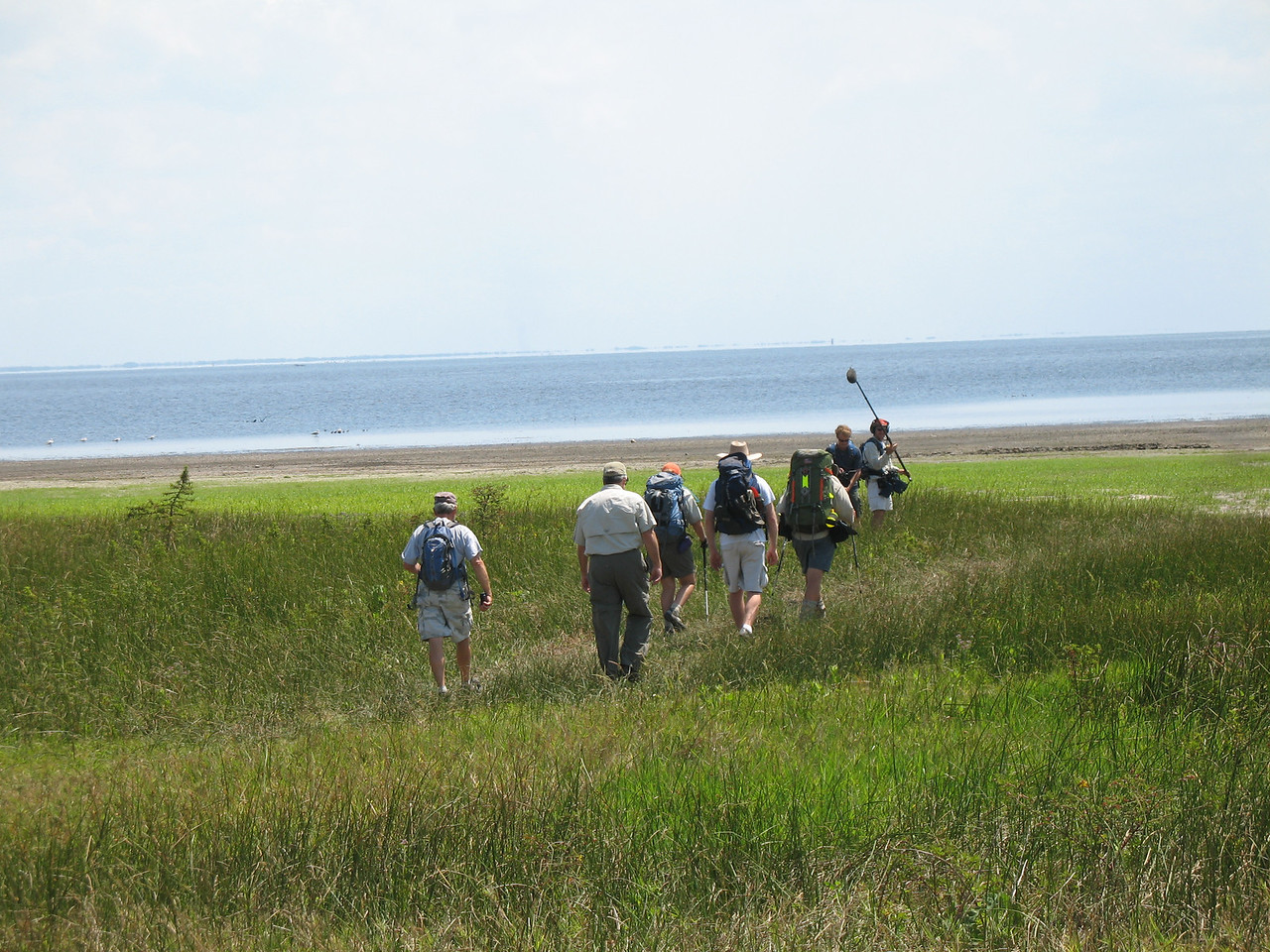 Heading through the grassy shoreline to the lake's receded shoreline