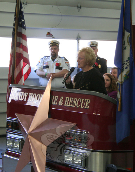 "First Selectman Pat Llodra encouraged everyone to ""slow down and recognize what each of these stars stands for."""