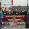Denise Daniels Biagi, center, sang the national anthem. From left is Gov Dannel Malloy, Lt Gov Nancy Wyman, Ms Biagi, State Senator John McKinney, US Senator Richard Blumenthal, US Senator Chris Murphy, and CT United Ride Executive Director Fred Garrity, Jr.