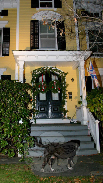 Wreaths and garland have dressed up the formal entrance at 3 Church Hill Road this season. A pair of wooden reindeer (not shown) also decorate this home's lawn.  (Hicks photo)