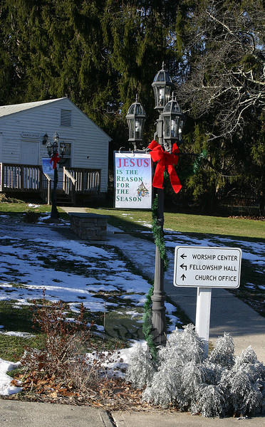 Banners on the light posts at Newtown Christian Church remind visitors of the reason behind this major holiday season.  (Hicks photo)
