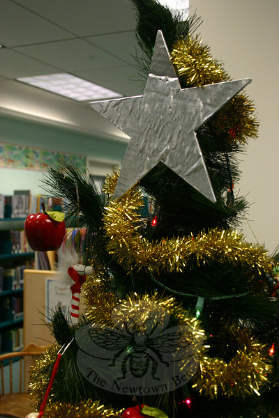 A star tops the Christmas tree in the Children's Department at C.H. Booth Library this season.  (Hicks photo)