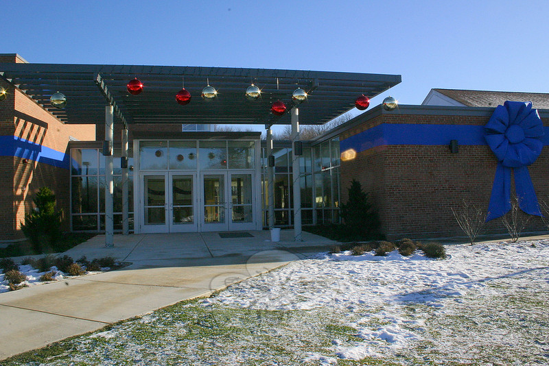 The entry to the parish hall at St Rose has also been adorned with oversize ornaments, matching the oversize blue ribbon that has been wrapped around much of St Rose School.  (Hicks photo)