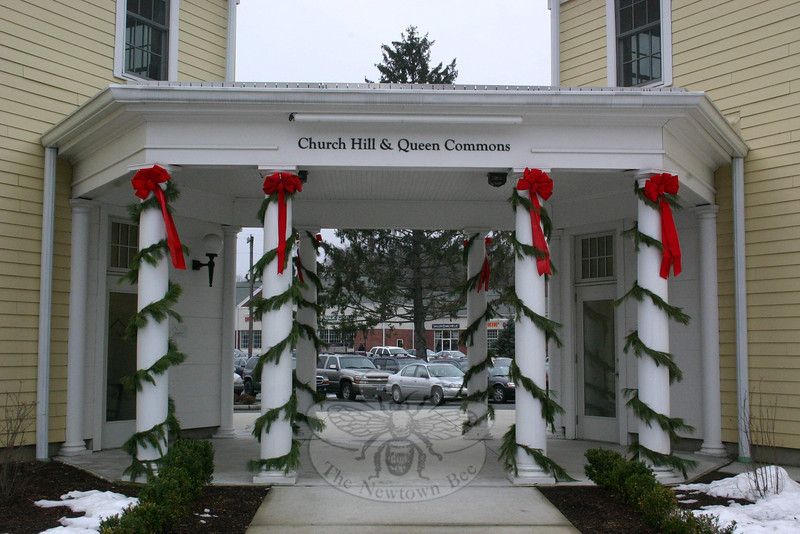 Pine roping and red bows surround the stores and offices at Church Hill & Queen Commons.  (Hicks photo)