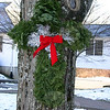 An evergreen cross has been placed on two of the trees leading to the main entrance at Newtown United Methodist Church.  (Hicks photo)