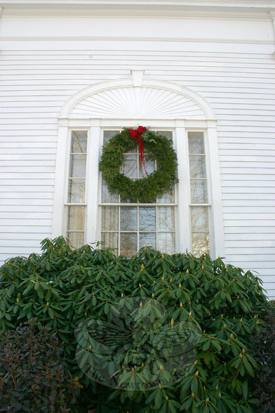 A large wreath on one of the windows facing Main Street at the original branch office of Newtown Savings Bank.  (Hicks photo)