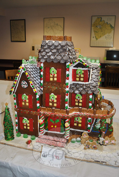 """A Gingerbread Mansion created by the Lundquist family took first place in the Family Division of the Newtown Youth & Family Services Gingerbread House Contest. Judging took place at C.H. Booth Library on Sunday, December 5. (For a look at all of the entries, see the slideshow attached to the story """"Newtown Blooms With Holiday Spirit In December,"""" online under the Features tab.)  (Crevier photo)"""