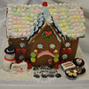 """This gingerbread Bake Shoppe, complete with doughnuts and cupcakes fashioned from """"O"""" cereal shapes, and an Oreo cookie walkway, won first place for Courtney Cohane and Sophia Andrew in the Child Group Division, Grade 3–5.  (Crevier photo)"""