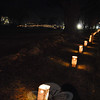 Newtown's holiday weekend opened on Friday, December 3, with the 26th annual tree lighting at Ram Pasture. Miles of luminaria led the way.  (Crevier photo)