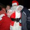 Santa Claus stands with Sharon, Joseph and Patrick Doherty during the festivities leading up to the Sandy Hook tree lighting Saturday, December 4.  (Bobowick photo)