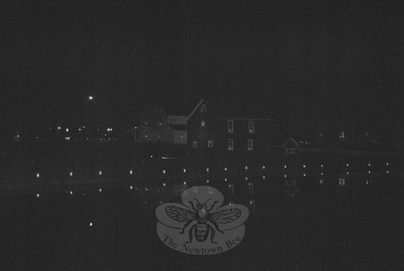 A view across Hawley Pond, toward Peg Jepsen's home on Ram Pasture, the night of the first of three tree lightings last weekend.  (Crevier photo)