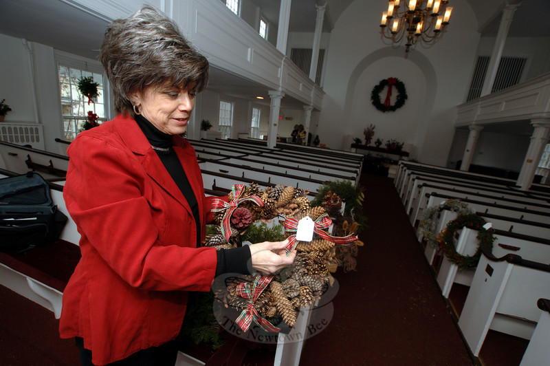 Garden Club of Newtown member Vicky Taloni, during the club's annual Greens Sale at Newtown Meeting House on Saturday, December 5.  (Bobowick photo)