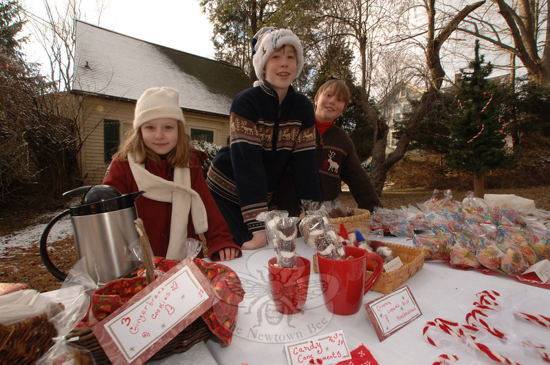 Kate Luongo and Henry and Felix Summ sold baked cookies and candy from a sidewalk table during Sunday's Holiday Festival.  (Bobowick photo)