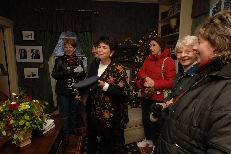 Beth Candwell (second from left) was a house captain at 65 Main Street, one of the homes featured on the walking tour of the 24th Newtown Holiday Festival on December 6.  (Bobowick photo)