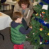 """Tracy Millander and her son Jason Benson, 3, examined the """"Bath Tree"""" donated by Girl Scout Troop 50837.  (Crevier photo)"""
