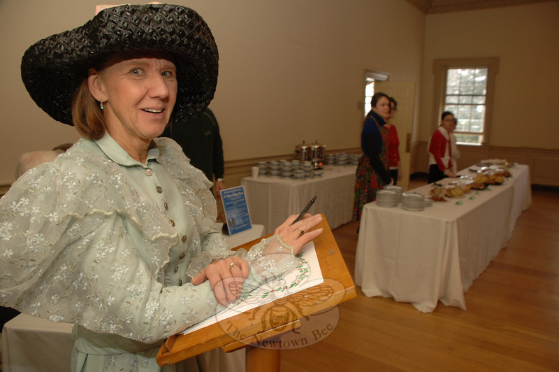 Linda Rocco was one of the greeters to the Victorian Tea, one of the events during the 24th Annual Newtown Holiday Festival.  (Bobowick photo)