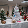 Beautifully decorated tabletop trees and other holiday decorations donated by various individuals and organizations fill the tables at the Festival of Trees, one of the Newtown Holiday Festival events. Visitors purchased chances to win the creations, with funds raised going to benefit Newtown Youth & Family Services.  (Crevier photo)