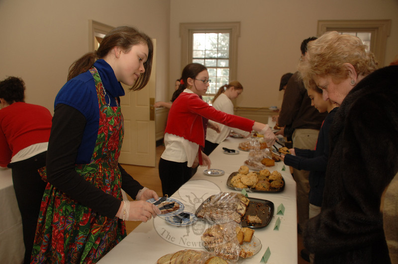 Caitee Talon and Amy Pruner helped guests with their selections at the Victorian Tea.  (Bobowick photo)