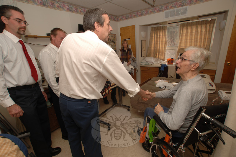 VFW Post 308 Men's Auxiliary members paid tribute to Masonicare at Newtown resident George Stalega, right,  who served in the Air Force.  (Bobowick photo)