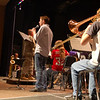 """Newtown High School student Andrew Nichols sang his version of Toby Keith's """"American Soldier"""" on Wednesday, November 11, during the school's Veterans' Day ceremony along with the NHS Concert Band and the 102nd National Guard Army Band.  (Hallabeck photo)"""