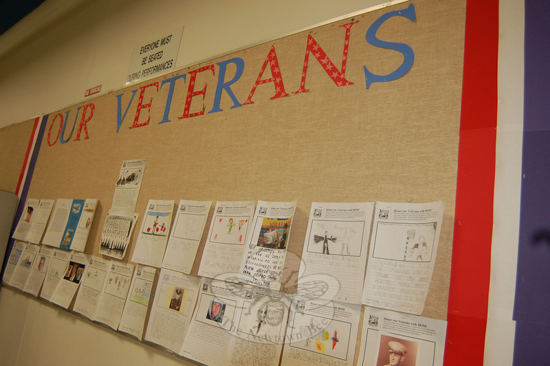 """A wall in the Head O' Meadow cafetorium was decorated for Veterans Day with """"Our Veterans"""" submitted by students in the school. (Hallabeck photo)"""