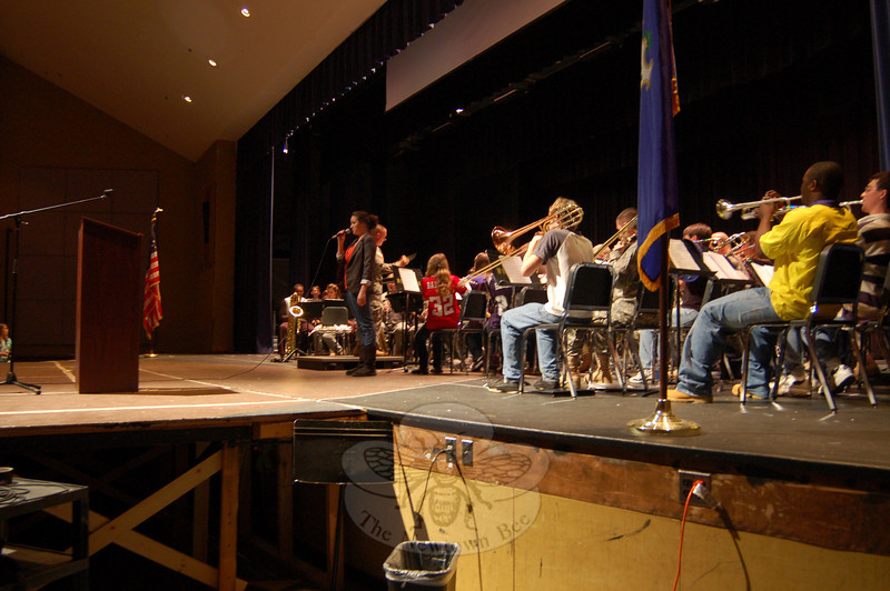 """Newtown High School student Hannah DeFlumeri sang her version of """"God Bless America"""" on Wednesday, November 11, during the school's Veterans Day ceremony along with the NHS Concert Band and the 102d Army Band.  (Hallabeck photo)"""