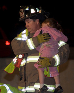 "This photo received an Honorable Mention for ""Photo Published in Newspaper or Magazine (circulation over 100,000)"".    This was published on the front page of the Daily Herald newspaper in May of 2008.  This photo is of Elgin FD Lt. John Fahy holding a 3 year old that was ejected from an SUV when it crashed on I-90 at Rt. 31, rolling several times before coming to a stop.  The little girl's 2 year old brother and her Grandmother died from their injuries the next day.  They too, were thrown from the SUV.  The driver and passenger from that accident fled the scene and were never found."