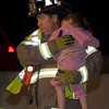 """This photo received an <b>Honorable Mention</b> for <B><i>""""Photo Published in Newspaper or Magazine (circulation over 100,000)""""</b></i>.    This was published on the front page of the Daily Herald newspaper in May of 2008.  This photo is of Elgin FD Lt. John Fahy holding a 3 year old that was ejected from an SUV when it crashed on I-90 at Rt. 31, rolling several times before coming to a stop.  The little girl's 2 year old brother and her Grandmother died from their injuries the next day.  They too, were thrown from the SUV.  The driver and passenger from that accident fled the scene and were never found."""