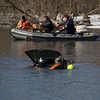 "This was the First Prize Photo <b><i>""For Best Fire Service Photo Published on a Web-based News Site""</i></b>.  There was a Porsche Cayenne floating down the Fox River called in by some fisherman up-stream.  The scramble was on to get inside it and see if anyone was IN the vehicle.  This photo was taken moments after the divers were able to get into the SUV only to find it empty (which was a good thing!).  The SUV was stolen out of Chicago earlier in the day and someone drove it out here, and right into the river."