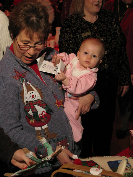Bonnie DeGone, from Baldwinsville, NY with granddaughter Bethany looking at the crafts.
