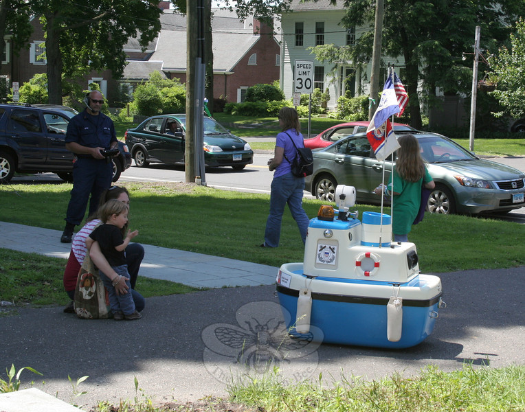Displays by the US Coast Guard were set up inside the church and on the front lawn, where Coastie the Coast Guard's mascot was also spending time making new friends.   (Hicks photo)