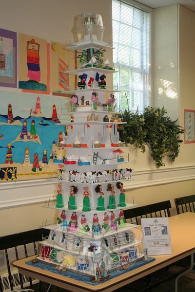 """The church's undercroft was used for workshops, classes and performances. It was also filled with more lighthouses that has been loaned to the church for the festival, including this """"Twelve Days of Light,"""" loaned by Theresa Rowe Obert of Danbury.   (Hicks photo)"""