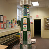 The green and white panels on the sides of this model lighthouse, set up in Trinity's undercroft, were all hand painted by Newtown children. It was one of hundreds of lighthouses that were displayed during the June 15 Lighthouse Festival, which welcomed guests of all ages.  (Hicks photo)