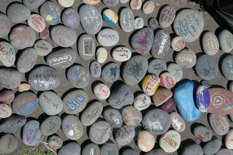Guests were invited to add messages on rocks that were laid around the base of the custom built lighthouse on the church's front lawn.    (Hicks photo)