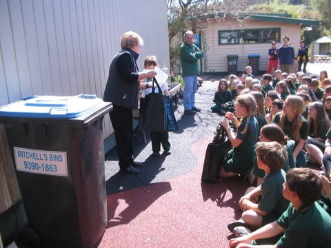 Lyn presenting a winner of competition Toolern Vale Primary