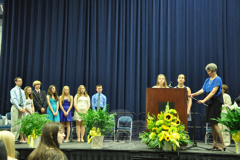"""Graduating eighth graders Claire Beiter and Julia Bogdanoff performed the """"Star Spangled Banner"""" during the moving up ceremony.   (Dietter photo)"""