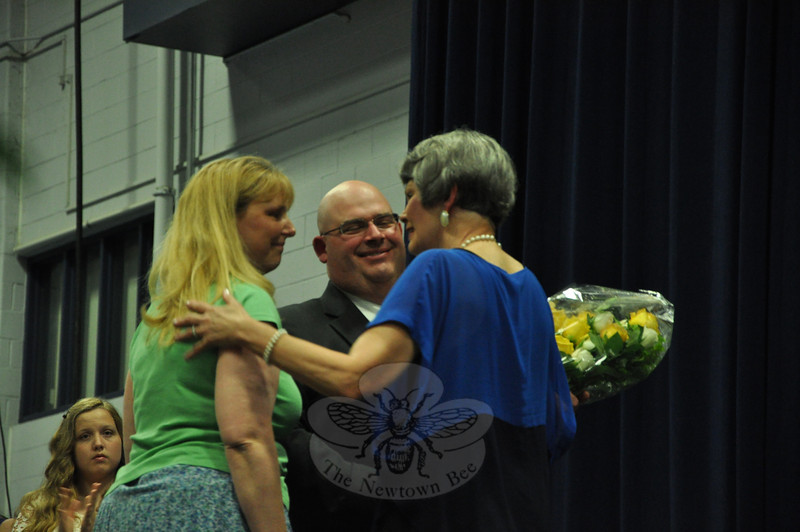 Newtown MIddle School Social Studies teacher Andrew San Angelo and science teacher Elizabeth Iaciofano recognized Ms Sherlock's tenure with speeches before presenting Ms Sherlock with a bouquet of flowers.   (Dietter photo)