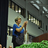 "Newtown Middle School Principal Diane Sherlock claps at the conclusion of the Newtown Middle School Moving-Up ceremony June 18, as graduating eighth grade students exited the O'Neill Center to ""Toreador March."" (Dietter photo)"